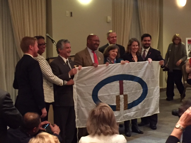 Deputy Director for Economic Development Alan Greenberger, Mayor Michael Nutter, Zabeth Teelucksingh and John Smith from Global Philadelphia presenting the flag of the Organization of World Heritage Cities